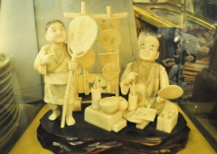 Japanese hand carved Ivory Genre group Of fan merchant and son
